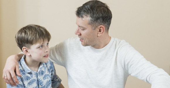 father-son-talking-floor_23-2148511422
